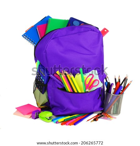 Purple backpack full of school supplies over a white background                 - stock photo