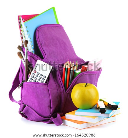 Purple backpack with school supplies isolated on white  - stock photo