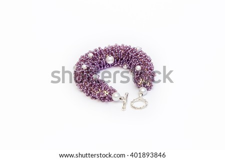 Purple beaded bracelet isolated 2 - stock photo