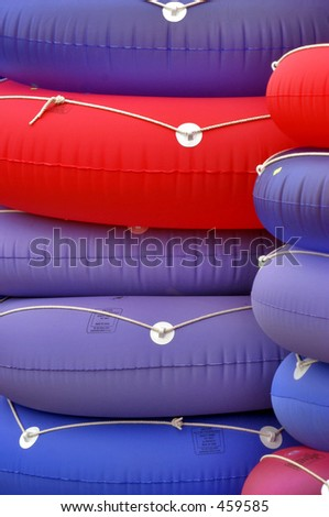 Purple, Blue and Red floats stacked on top of eachother - stock photo