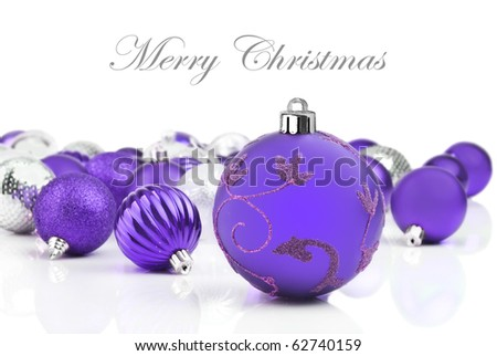 Purple blue  christmas decorations on a white background with space for text - stock photo