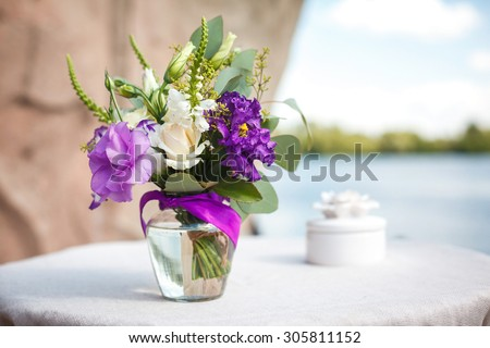 purple bouquet of flowers for a wedding ceremony - stock photo