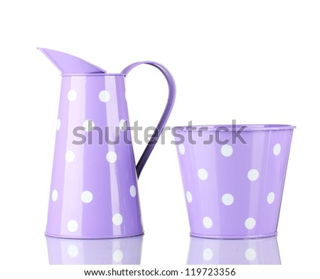 Purple buckets with white polka-dot isolated on white - stock photo