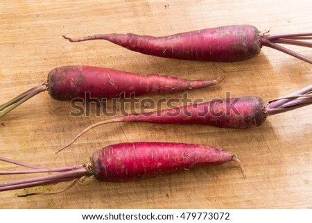 Purple Carrot on Wood