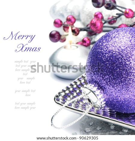 Purple Christmas ball on festive background - stock photo