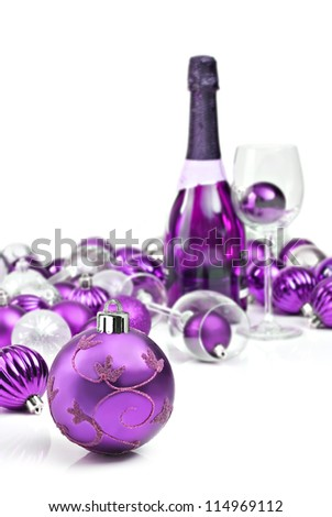 Purple christmas ornaments with wine - stock photo