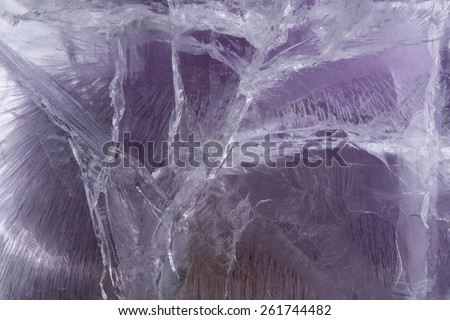 Purple colored ice texture background made of frozen ice - stock photo