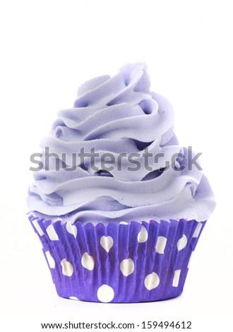 Purple cupcake isolated on white background - stock photo