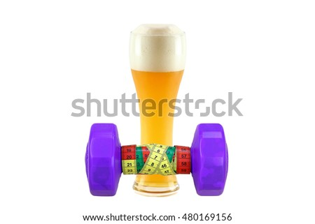 Purple dumbbell with measuring tape with glass of cold bavarian wheat beer isolated on white background