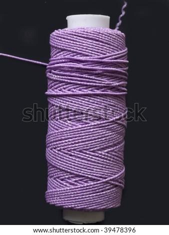 purple elastic bobbin - stock photo