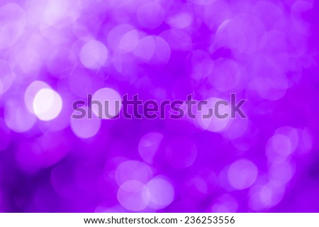 Purple festive Christmas background. Abstract with bright twinkles, sparkles, blurred, defocused light. - stock photo