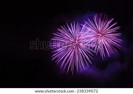 Purple fireworks display - stock photo