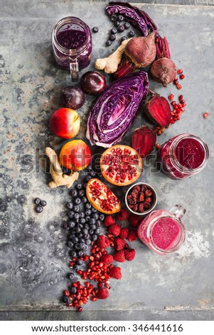 Purple fruit and veggies background with superfoods bowl. overhead on stone surface with natural light. New trend colorful rustic collage - stock photo
