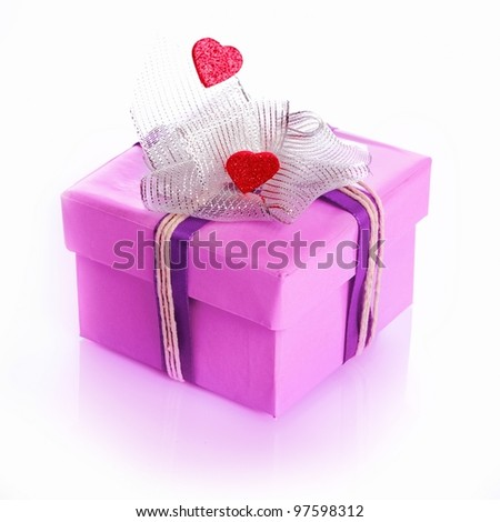 purple gift box decorated with hearts and a ribbon or bow isolated on white