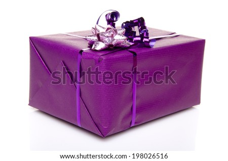 Purple gift box with a purple bow, isolated on white