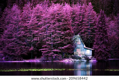 purple infrared landscape with alone villa on calm lake for background or poster - stock photo
