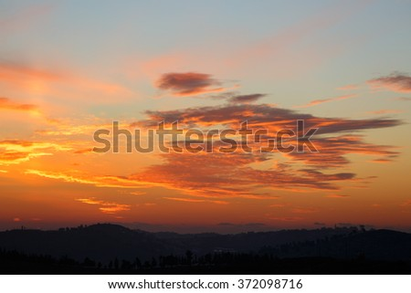 Purple majestic sunset in the mountains - stock photo