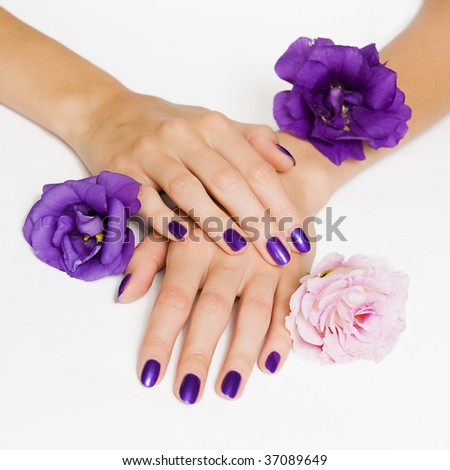 Purple manicure with delicate flowers - stock photo