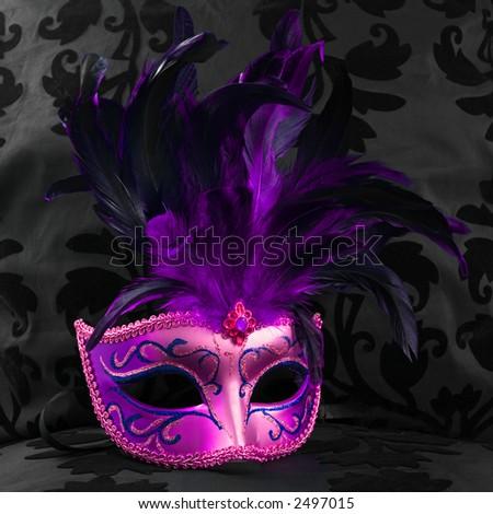 purple mask on a black velvet background (Venice) - stock photo