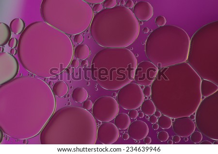 purple oil bubbles on a water surface abstract background - stock photo