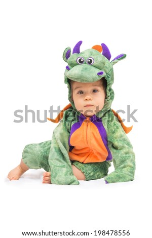 Purple, orange and green dragon costume on baby isolated on pure white - stock photo