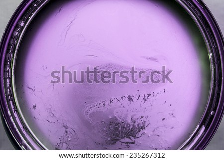 Purple paint in cans - stock photo