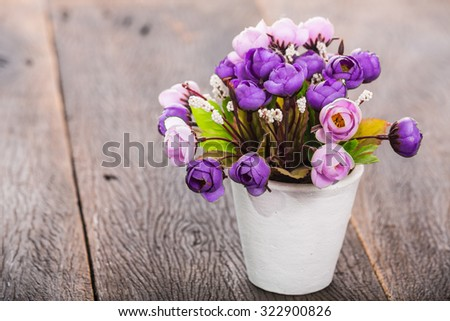 Purple roses flower in vase decor on wood table. - stock photo