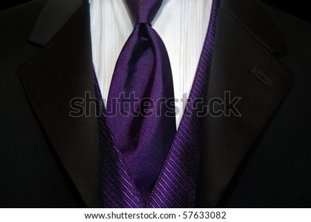 purple satin tie with black tux - stock photo