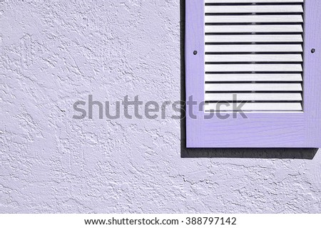 Purple shutter and exterior stucco wall - stock photo