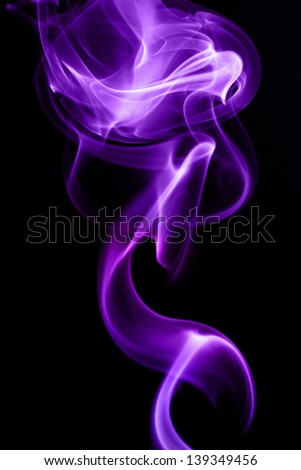 Purple smoke in black background - stock photo