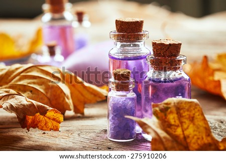 Purple Spa still life with autumn leaves on wooden background - stock photo