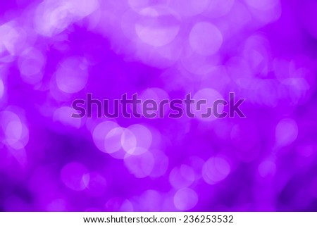 Purple special occasions background. Abstract with bright twinkles, sparkles, blurred, defocused light. - stock photo