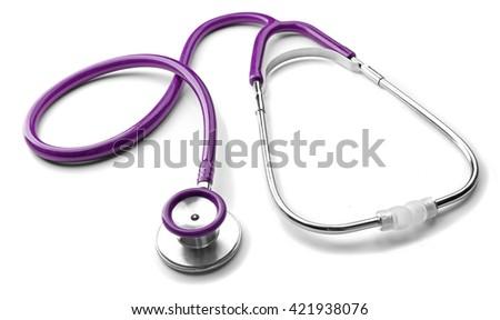 Purple stethoscope isolated on white - stock photo