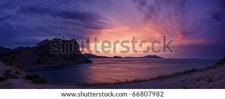 purple sunrise on rocky bay - stock photo