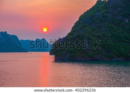 Purple sunset in Halong Bay, Vietnam, Southeast Asia - stock photo