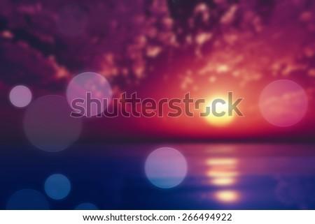 purple sunset over tropic sea blurred background - stock photo