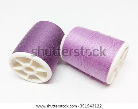 Purple thread isolated on white background