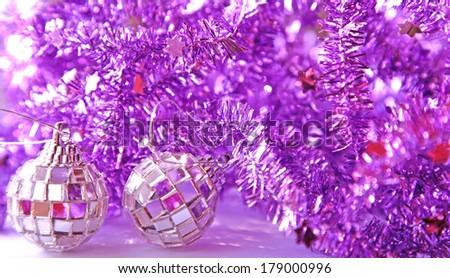 purple tinsel and glitter balls - stock photo