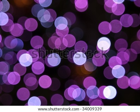 Purple tint holiday bokeh - stock photo