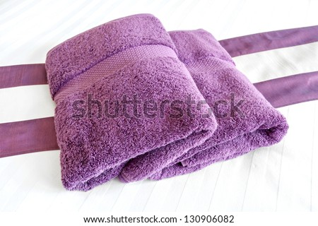Purple towels on the bed rooms - stock photo