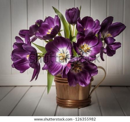 purple tulips in vase - vintage style - stock photo