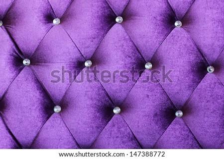 Purple velvet cushion is beautiful backdrop.  - stock photo