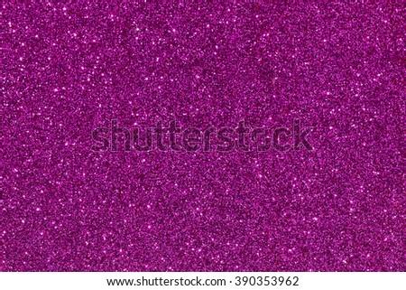 purple/violet glitter texture defocused background  - stock photo