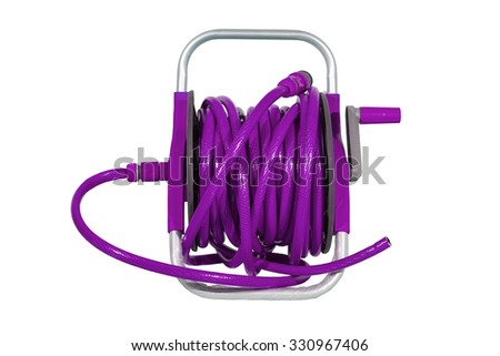 purple watering garden hose on the spool isolated on white background. - stock photo