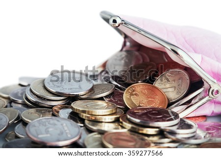purse and coins isolated on white background. focus on the coins in the purse - stock photo