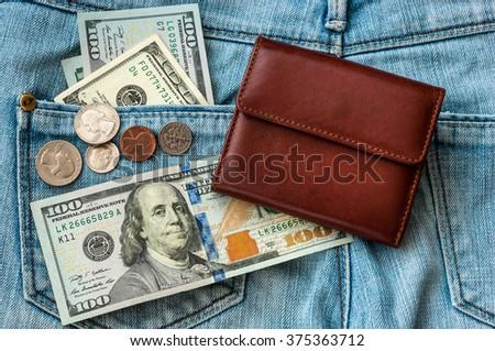 purse money on jeans - stock photo
