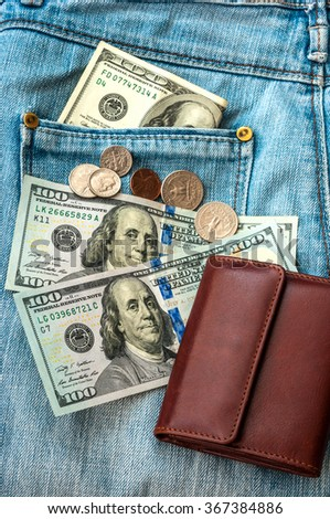 purse money. on jeans background. - stock photo