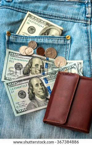 purse money. on jeans background. - stock photo