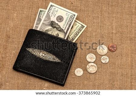 purse money. on linen cloth background. - stock photo