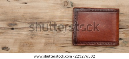 purse on wood background  - stock photo